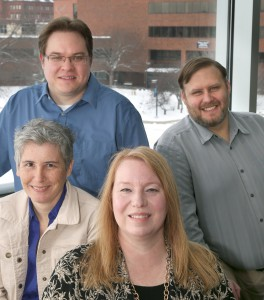 UW-Stout professor Jen Grant (left) is pictured with Andrew Aspaas, Christopher Lutz and Patricia Pieper, of Anoka-Ramsey Community College, Tuesday, January 6, 2015. Stout's National Science Foundation grant, in the Advanced Technology Education program, is a collaboration with faculty at Anoka-Ramsey Community College. (UW-Stout photo by Brett T. Roseman)